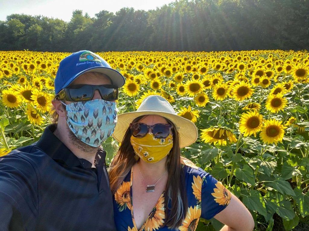 Amanda and Elliot in sunflowers