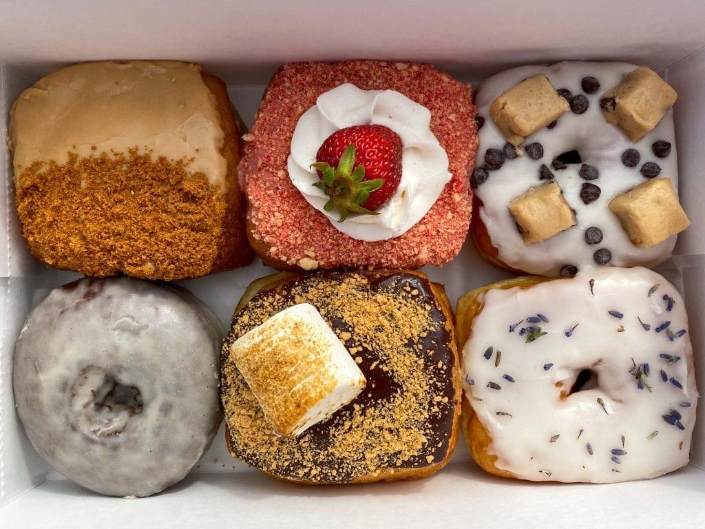 A half dozen Vegan Doughnut Company donuts
